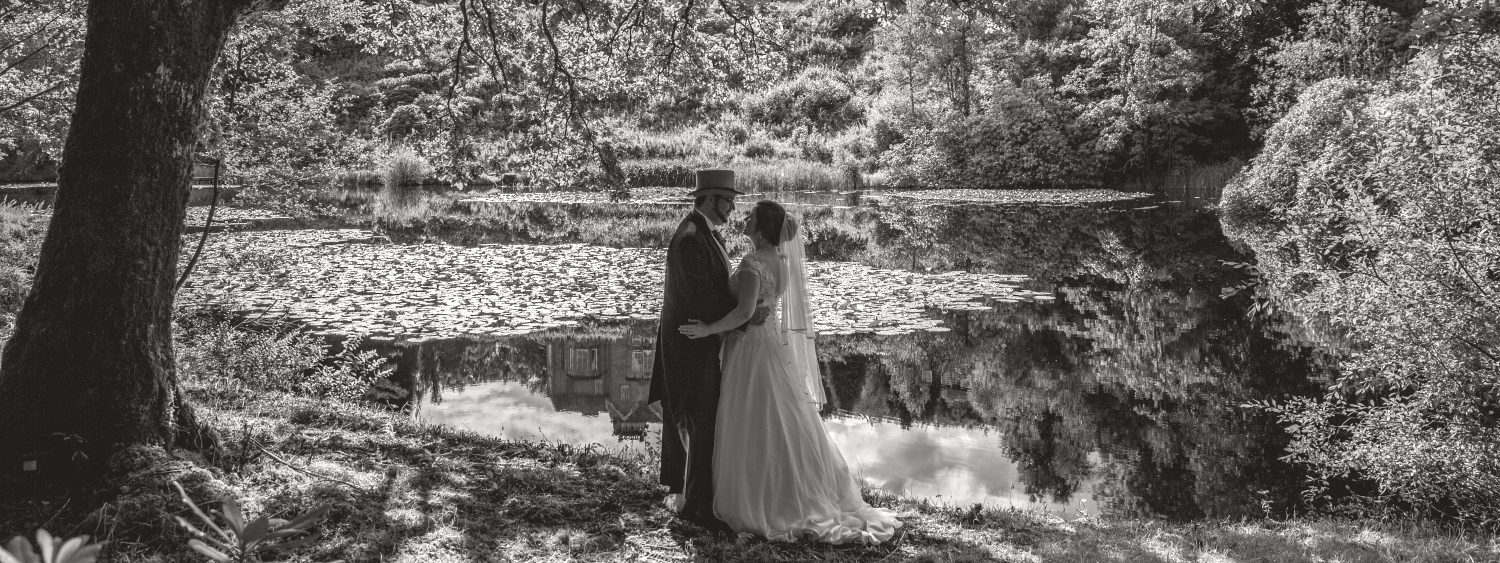 Bride and Groom standing beside the loch